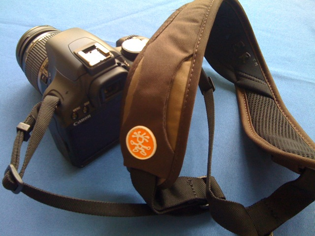 That would be the Crumpler Industry Disgrace neck strap.