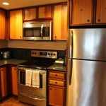 Microwave, stove, refrigerator, and hand towels